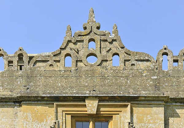Gloriously elaborate battlement centrepiece at Stanway House.